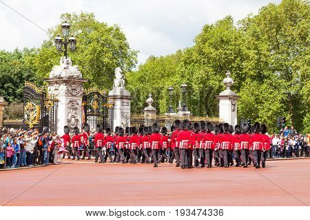LONDON, UNITED KINGDOM - JULY 11, 2012: Soldiers of the Coldstream Guards march into Buckingham Palace during the Changing of the Guard ceremony.