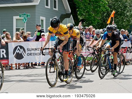 STILLWATER, MINNESOTA - JUNE 18, 2017: Overall race winner Colin Joyce (first cyclist from left) in peloton at the 2017 North Star Grand Prix Men's Stillwater Criterium. It is the final stage of a six-stage annual race.