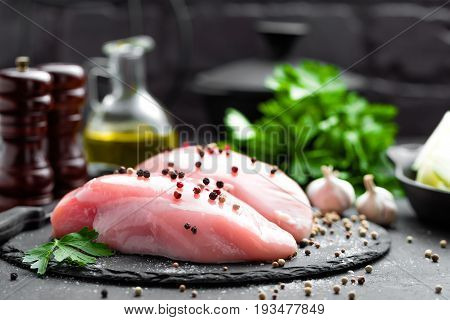 Raw chicken breasts, fillets on black background, closeup