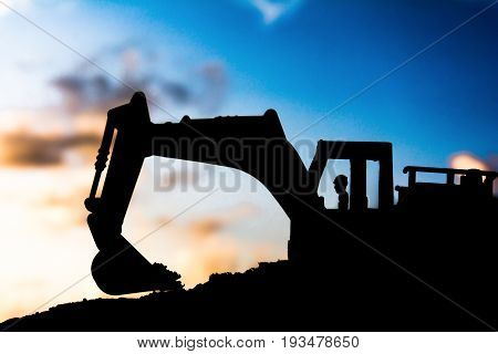 Silhouette Tracked Excavator Sand And Stone And Sky Background