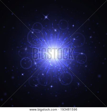 Brilliant blue star with a bright light effect isolated on a dark background