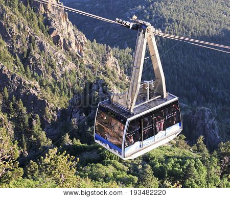 ALBUQUERQUE, NEW MEXICO, JUNE 18. The Sandia Peak Aerial Tramway Observation Deck on June 18, 2017, in Albuquerque, New Mexico. A Sandia Peak Aerial Tramway Uphill Tramcar Seen from the Observation Deck in Albuquerque, New Mexico.