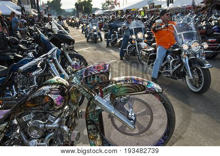 Sturgis South Dakota - August 9 2014: Riders in the main street of the city of Sturgis in South Dakota USA during the annual Sturgis Motorcycle Rally