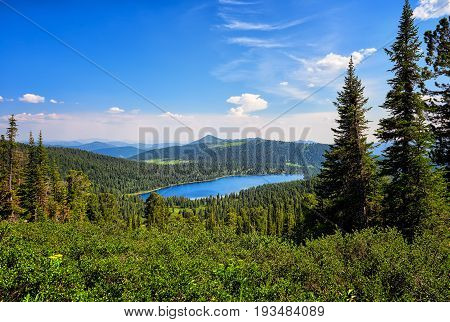 Lake In Dark Coniferous Taiga. Nature Park Ergaki.
