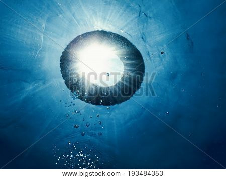 Life buoy in the water underwater. Underwater Bubbles