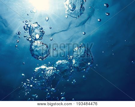 Underwater Bubbles Sunlight Through Water Surface. Underwater Background.