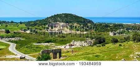 Antique ruins amphitheatre and gate near Patara beachTurkey.