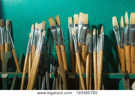 dusty small paintbrushes in various sizes and shape