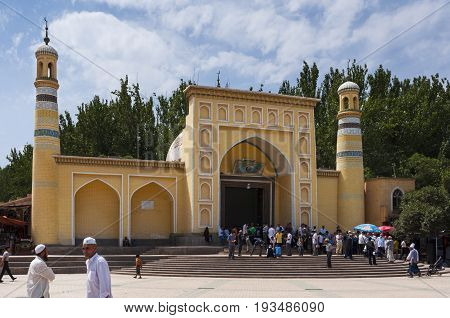 Kashgar China - August 14 2012: People in front of the Id Kah Mosque in the city of Kashgar in China