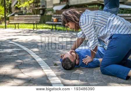 girl trying to find help for an unconscious guy