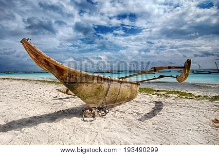 Old traditional zanzibar boat dhow on the beach. Hdr Photo.