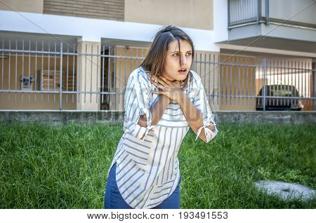 girl searching help while she's chocking during feeding