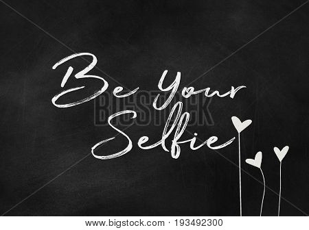 inspirational text be your selfie on textured black chalkboard with heart flowers