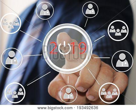 Businessman Pushing 2019 On Virtual Screens . Business Innovation,business Vision , Webinar, Launch