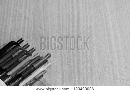 Many Ballpoint pens on the wood table