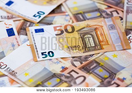 A collection of euro banknotes with nominal fifty