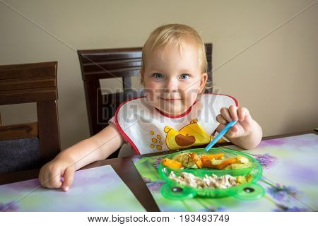 Little girl eating lunch at the table