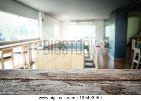 Selected focus empty old wooden table and Coffee shop or cafe blur background with bokeh image. for your photomontage or product display.
