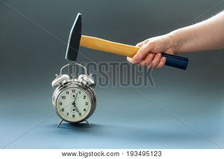 Hand hammer turns off the alarm clock