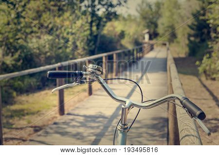 Bike path and bicycle handlebar close-up. Bicycle friendly city. Eco-friendly transport and healthy lifestyle concept.