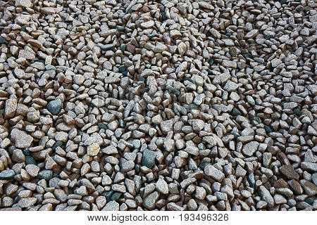 Gray texture of small stones of building rubble
