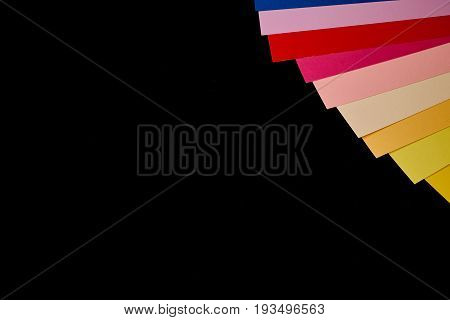 Multicoloured stripes on blackboard with copy space