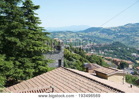 Panorama of Republic of San Marino and Italy from Monte Titano City of San Marino. City of San Marino is capital city of Republic of San Marino located on Italian peninsula near Adriatic Sea.
