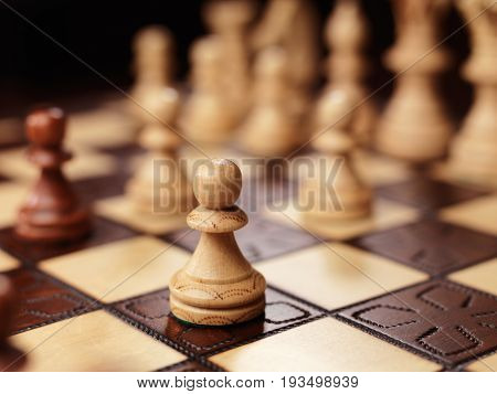 Pawn chess piece on a chessboard. Conceptual