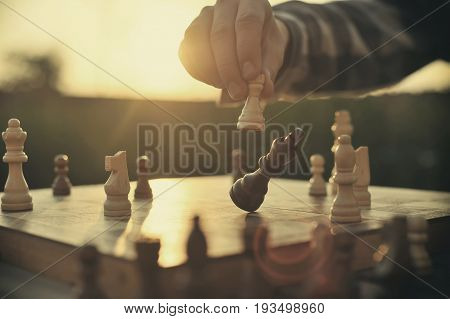 Man playing chess doing strategic move to win