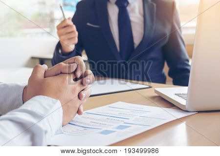 Job application interview. Executive manager hold up pen to Sign Approval Close up of male hands man feel worried stressed be nervous Hiring concept.