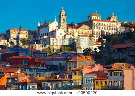 Aerial view with traditional multicolored quaint houses in Old town of Porto in the sunny morning, Portugal