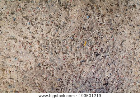 Background Texture Of A Cement Wall Or Concrete Pavement With Inclusion Of Small Gravel Stones