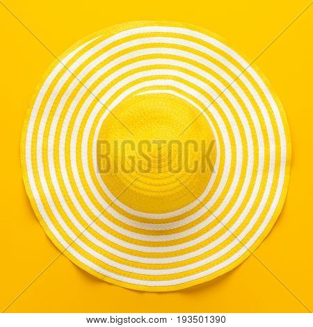 top view of yellow striped retro hat. yellow hat close-up. summer style yellow hat. background of yelloow striped hat