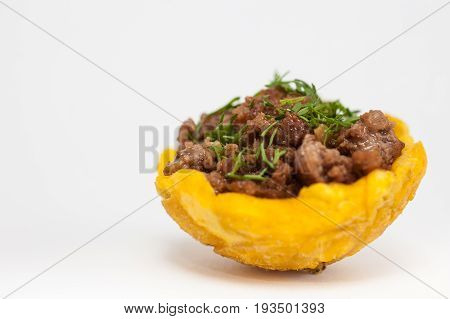 Plantain cup filled with ground beef on white background