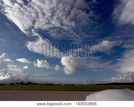 Beautiful cloud formations Wads of cottony white clouds cover the skies above Saipan International Airport