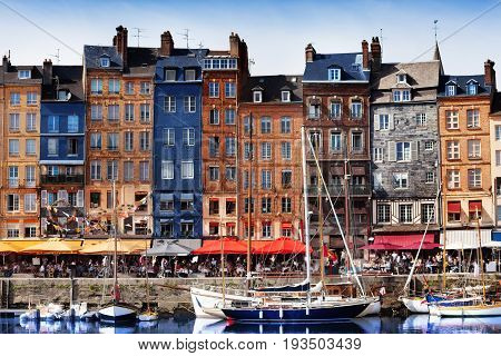 Beautiful color houses and marina of Honfleur harbour in Normandy, France