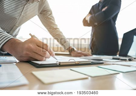 Business team meeting present. secretary presentation new idea and making report to professional investor with new finance project plan during discussion at meeting.