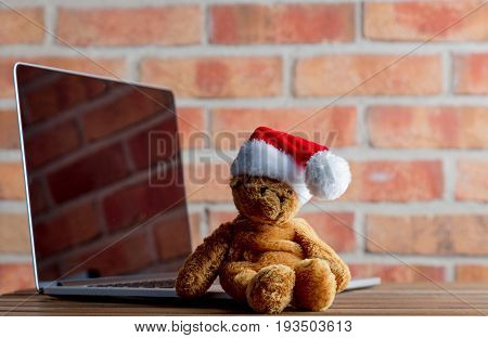 Christmas Teddy Bear Toy And Laptop