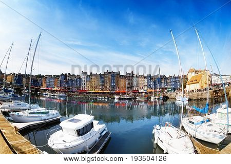 Beautiful panoramic view of old Honfleur harbor with yachts and color houses, Normandy, France