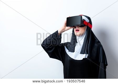 Young Surprised Nun With Virtual Reality Glasses