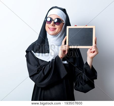Young Smiling Nun With Board