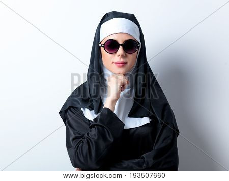 Young Serious Nun With Sunglasses