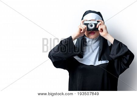 Young Smiling Nun With Photo Camera