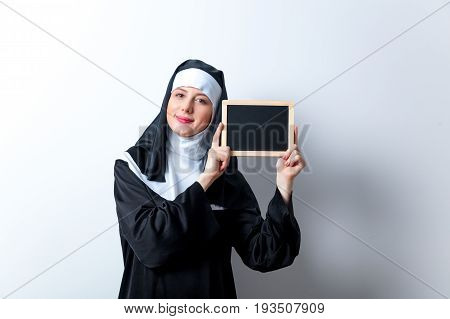 Young Smiling Nun With Black Board