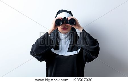 Young Surprised Nun With Binoculars