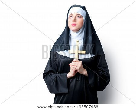 Young Serious Nun With Cross