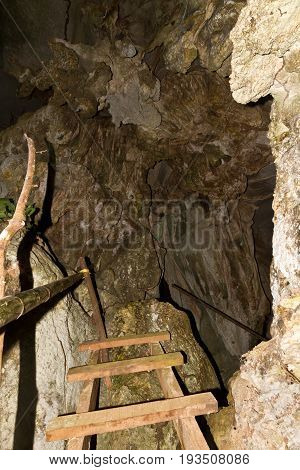 pathway underground cave in Laos, with stalagmites and stalactites.