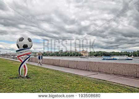 SAINT - PETERSBURG, RUSSIA - JULY 2, 2017: Universitetskaya (University) Embankment in the period of The 2017 FIFA Confederations Cup. On the background is The Neva River and The Admiralty Building