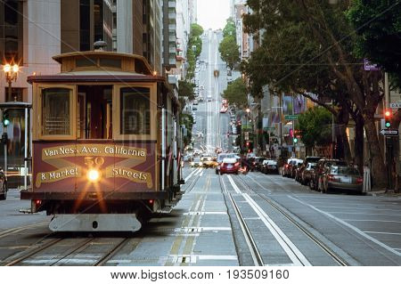 view of historical cable car on famous van ness ave  in san francisco
