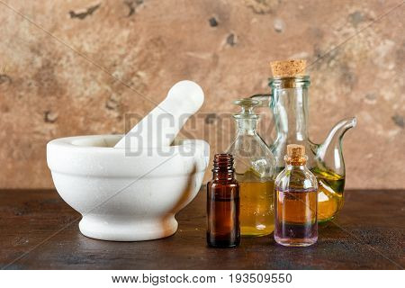 Bottles natural fragrance aroma essential oil with dry flower on table for aroma spa alternative therapy and medicine